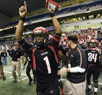 Cedar Hill quarterback Will Cole cheers after the Longhorns won the 2006 Class 5A Division II state championship against Cypress Falls. Cole had 2,966 yards rushing and 41 touchdowns in leading Cedar Hill to a 16-0 record.<252><252><252><252><252>DMN file photo - 113045