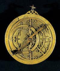 A planispheric astrolabe from Spain made from cast and engraved brass is part of the new Dallas Museum of Art exhibit.AP