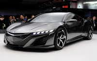 Acura's NSX concept vehicle was among the models unveiled at the Detroit auto show on Tuesday, the last day of the event's press preview. It opens to the public Saturday and runs through Jan. 27.
