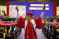 Graduate Jose Villanueva celebrated after receiving his diploma at the 54th annual commencement of Thomas Jefferson High School in May at the Alfred Loos Field House in Addison.