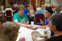 Marian Pearn (left) and Linda Muscle play cards before lunch at Flower Mound's senior center. The proposed center would have separate rooms for cardplayers.