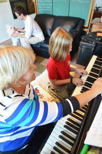 Lily Jones (9) of Garland Christian Academy practices private piano lessons for her upcoming December recital performance. Private music lessons teacher Becca van Uum's has been teaching music to children in the area for twenty five years from her Garland home.