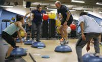 Fitness specialist Cari Cregar leads exercises at the City Hall gym. Almost 80 percent of those in the city's health plan are overweight or obese.Nathan Hunsinger  -  Staff Photographer