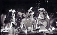 Bunnies chat at the bar of the Dallas Playboy Club, July 27, 1977.