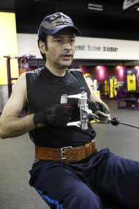 Magician David D'Angelo works out at the Planet Fitness in Garland, where it's not exactly abracadabra to keep the abs in shape.