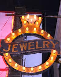 """Five """"diamonds"""" in this light bulb sign flash on and off to make the gem sparkle. """"Antiques Roadshow"""" estimated its value at $8,000-$12,000."""