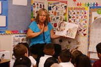 Dual-language teacher Gina Fernandez reads a Spanish language book to her first-grade students at Brandenburg Elementary as part of Irving ISD's dual-language program.