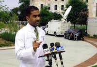 Dr. Jay Varkey, an infectious disease specialist at Emory Healthcare, speaks with reporters, Saturday, Aug. 2, 2014 in Atlanta. Varkey is part of a team of doctors who will treat the two American aid workers infected with the Ebola virus. The workers will be treated at Emory University Hospital in Atlanta.Alex Sanz - AP