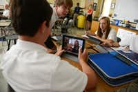 Luke Logan displays classmate Emma Boeckman on his iPad's video camera, which is then displayed on the classroom's projector screen. Adam Willis, seventh-grade science teacher, incorporates the use of iPads into many lessons at Episcopal School of Dallas. The school is making an effort and joining other private schools and school districts in getting technology used in the classroom.
