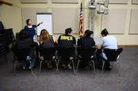 Volunteer Raquel Morales teaches English to a group of beginning ESL students in Farmers Branch. The 20-year-old program has reached attendee numbers as high as 80 students a night, though lately it hass plateaued at 20 to 30.Rose Baca - neighborsgo staff photographer