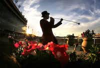 Bugler Jay Elmore of Dallas warmed up for the Call to the Post between races on opening day at Lone Star Park at Grand Prairie.Tom Fox - Staff Photographer