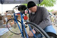 """Bike Irving co-founder Dave Vest repairs a donated bike during """"Wrench Day.""""Rose Baca - neighborsgo staff photographer"""