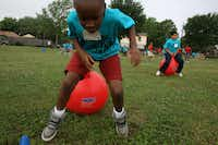 """Mesquite's Shaw Elementary School gives students like Myles Harris an annual """"Play Day"""" to compete and exercise with one another."""