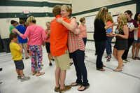 Fifth-grade teacher Melanie Willett hugs former student and graduating senior Ryan O'Dell during a reunion with former teachers and students at Mathews Elementary School in Plano.Rose Baca - neighborsgo staff photographer
