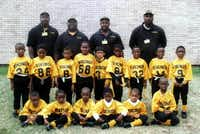 Lincoln High School dual-sport twins Erick and Derrick Neal (second row, second and third from right), have played sports together their entire lives, including flag football with the West Dallas Vikings in 2001.DMN file photo <137>Courtesy Photo<137> - digital file