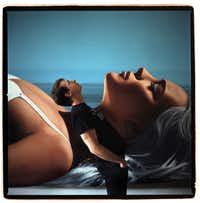 Richard Phillips photographed exclusively for FD Luxe in his New York studio by Béatrice de Géa. Behind Phillips, his own work in progress, a painting of a moment from his own 90-second film starring Lindsay Lohan.