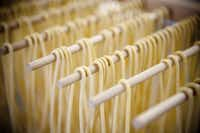Homemade spaghetti noodles hung out to dry.JUSTIN CLEMONS