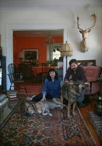 Art historian and gallery owner Cris Worley, artist Erick Swenson, dogs Rudy and Benson