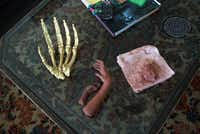 On the living-room coffee table, various hands, and a mound of clay that may one day be a maquette for a Swenson work.
