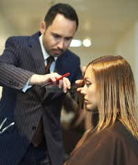Henry cutting Tara Tonini's hair after she has had her ombre treatment.