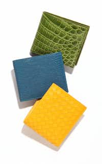 yellow woven wallet, $440, blue lizard wallet, $630, green crocodile wallet, $1,160, all Bottega Veneta