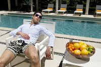 Thom Browne striped rugby, $310, Barneys New York; Balmain swim trunks, $625, Forty Five Ten; silver aviator sunglasses, $14, Urban Outfitters.Steve Wrubel