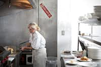 Tracy Miller in the kitchen of her Rosemont restaurant.