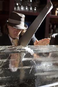 "Mixologist and co-owner Eddie ""Lucky"" Campbell saws ice into small blocks to chip artisanal ice for cocktailsJUSTIN CLEMONS"