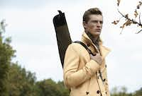 Dsquared2 wool pea coat, $1,395, Forty Five Ten; Polo Ralph Lauren cashmere plaid sweater, $895, Neiman Marcus; and wool tweed gun case, $225, Beretta Gallery