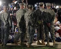 Soldiers listen in the wings as Lt. Gen. Mark Milley address the media during a news conference at the main gate to Fort Hood, Wednesday, April 2, 2014, in Fort Hood, Texas. A soldier opened fire Wednesday on fellow service members at the military base, killing three people and wounding 16 before committing suicide, authorities said.Eric Gay - The Associated Press