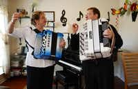 Elena and Gregory Fainshtein let their final note sound after playing a song on the accordion in their Plano home.Rose Baca - neighborsgo staff photographer