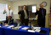 Council members (from left) Steve Herrmann, Joe Burger and Mayor Lorne Megyesi stand to be sworn into their new positions before a Fate City Council meeting, while Cameron Cowan, the only council member remaining from the previous council, looks on. All of the City Council incumbents up for re-election lost in the May 10 election.Rose Baca