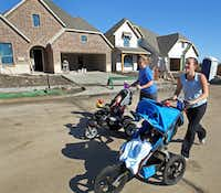 Jessica Thompson (right) and Ashley Crews go for a morning jog in the Woodcreek subdivision in Fate, where new houses are springing up. Census data showed the Rockwall County city grew at the fastest rate of any in the state in the last decade, with its population rising from 497 in 2000 to 6,,357 in 2010.