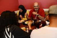 Badirah Ghosheh (left) and Reyad Ghosheh (right) eat lunch with friends at Afrah Mediterranean Restaurant and Pastries in Richardson. The restaurant and surrounding neighborhood were ranked to be one of the best places for foodies by The Dallas Morning News' food critic, Leslie Brenner.
