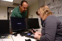 Zoltan Szabo, head of the digital forensics and information assurance program at Richland College, helps student Dianna Stiller extract information from various devices in his digital forensics class. The northeast Dallas community college recently received a $510,894 grant from the National Science Foundation, part of a $63 million federal program to improve cybersecurity led by two-year schools.