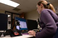 Richland College student Holly Horter extracts information from from a cell phone in her digital forensics class. The northeast Dallas community college recently received a $510,894 grant from the National Science Foundation, part of a $63 million federal program to improve cybersecurity led by two-year schools.