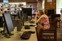 Anne Stone uses a computer at the Fretz Park Branch Library in Dallas. The library closed on Sunday to begin a year-long, $6.5 million renovation project that includes an almost 5,000-square-feet expansion.Photos by Rose Baca