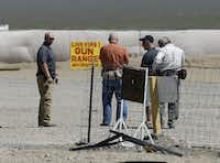 People are seen at the Last Stop outdoor shooting range Wednesday, Aug. 27, 2014, in White Hills, Ariz. Gun range instructor Charles Vacca was accidentally killed Monday, Aug. 25, 2014 at the range by a 9-year-old with an Uzi submachine gun. (AP Photo/John Locher)John Locher - AP