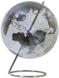 Merging modern style with traditional appeal, a crystal globe will give panache to Dad's office. The 12-inch, clear globe has silver continents marked with political boundaries and is bisected by a stainless-steel axis base. Crystal Marquise Desk Globe, $169, at Cantoni, Dallas, and cantoni.com.D2  - Cantoni