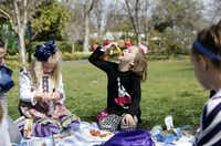 Jules Patterson, 5, left, and Emerson Dell, 7, both of Plano, sit with friends during a picnic on an area of green grass adjacent to The Paseo walkway during the Dallas Blooms floral festival, on Wednesday, March 19, 2014 at the Dallas Arboretum in Dallas.Ben Torres - Special Contributor