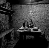 Dr. Jeff Gusky photographed this image Dec. 6, 2011. It shows French soldiers' dining area underground with wine bottles, canteens and a serving dish in Vauquois, France.Photo by DR. JEFF GUSKY  - jeffgusky.com
