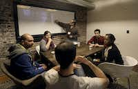 In this Saturday, Feb. 8, 2014 photo, participants Abhishek Agarwal, clockwise from left, Cristina Gorrino, Christopher Montano, Yoni Blumberg, Fanya Young, and Dante Cassanego meet during a coding and team formation session at FinCapDev San Francisco Hackathon in San Francisco. A record 1,500 hackathons around the world are planned for this year, up from just a few dozen in 2010, and their focus is broadening from developing lucrative apps to solving problems with coding for an array of issues including dental, fashion, immigration, transgender and social justice. (AP Photo/Jeff Chiu)Jeff Chiu - AP