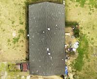 An EagleView photo shows hail damage in Jackson, Miss. The company has built a photo library of the country's rooftops.Pictometry International