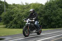 Employee Ben Lund demonstrates Harley-Davidson's new electric motorcycle at the company's research facility in Wauwatosa, Wis.M.L. Johnson - AP