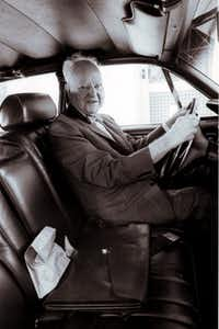 Texas oil billionaire H.L. Hunt, sits in his old car with his sack lunch he took to work everyday to his office in Dallas, Texas.