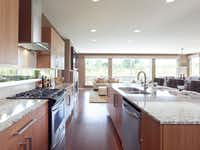 The builder's houses have open floor plans with lots of natural wood and light.