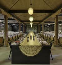 The St. Helena facility features a restoration of the winery site's historic Bergfeld Building, which dates from 1885. The Founders Cellar features blown-glass lighting by contemporary artist Tristano di Robilant, and the table is a handmade custom tree trunk with glass.Adrián Gregorutti  -  Special Contributor