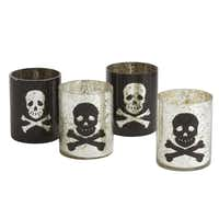 Eerie light Skull and crossbones votive holders of silvered glass are perfect as a hostess gift or party favor for trick-or-treaters. 4.25 inches high. The set of four includes two silver and two black with reverse graphics. $13.30 on sale at wisteria.com