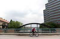 Andre Herron, who lives in the Las Colinas Urban Center, rides his bike around the area, which was rated the healthiest place to live in Irving and Coppell.