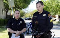 Highland Park police Sgt. Lance Koppa (right), with Dallas police Lt. Max Geron, gave information about the crash, but no description of suspects was issued by late Tuesday.Lara Solt  -  Staff Photographer